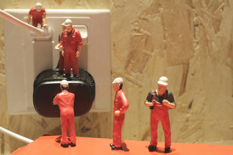 Miniature people Network Engineers At Work. The Miniature people Network Engineers At Work royalty free stock photo