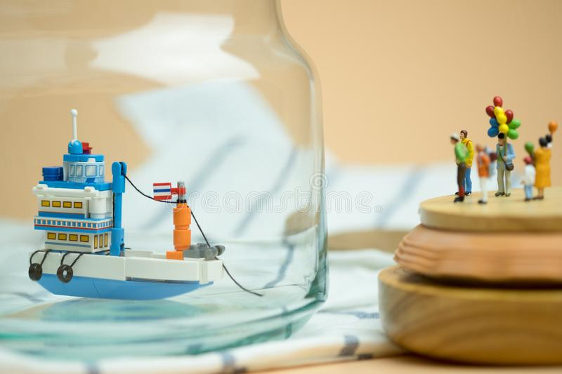 Miniature people: Passenger waiting generic Thai fishing ship. Travel in Thailand. Concept summer travel stock images
