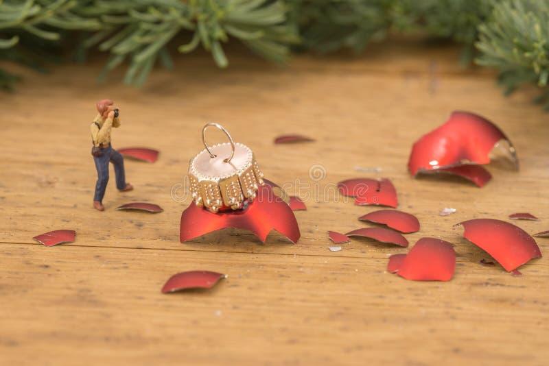 Miniature of photographers and broken christmas balls stock photo