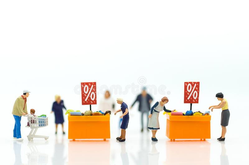 Miniature people : Shoppers with discount for shopping items using as shopping business concept.  royalty free stock images