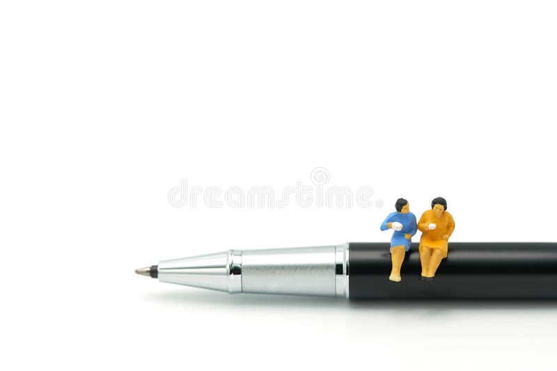 Miniature people Sit on the pens, exchange ideas, discuss problems using as background business concept and finance concept with c royalty free stock photos