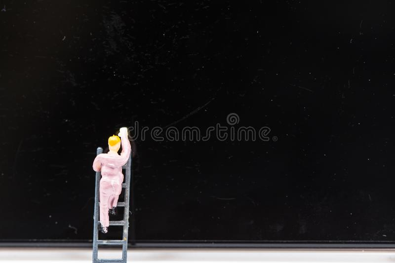 Miniature people : small figures businessmen Cleaning on Phone S. Creen with copy space and using as background technology concept, business plan concept,Stock royalty free stock images