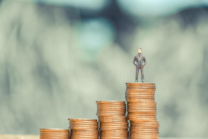 Miniature people, small figures businessmen stand on top of coin. S. Money and Financial, Business Growth concept. shallow focus in soft tone royalty free stock photos
