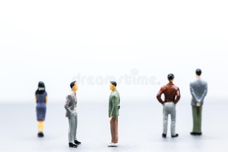 Miniature people : small figures businessmen stand on white Back. Ground with copy space and using as background finance business team competition concept royalty free stock photos