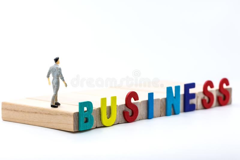 Miniature people : small figures businessmen stand on wooden Block staircase with copy space and using as background financial bu. Siness team competition royalty free stock photography