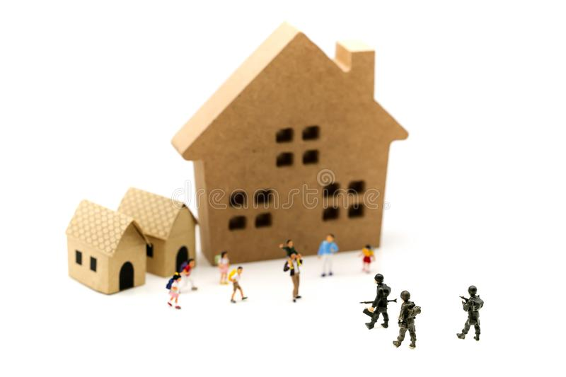 Miniature people : Soldier go home after mission complete with c royalty free stock photo