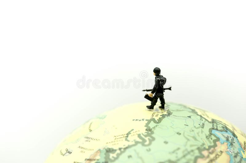 Miniature people : soldiers team with world map,War, army, military, guard concept. stock photography
