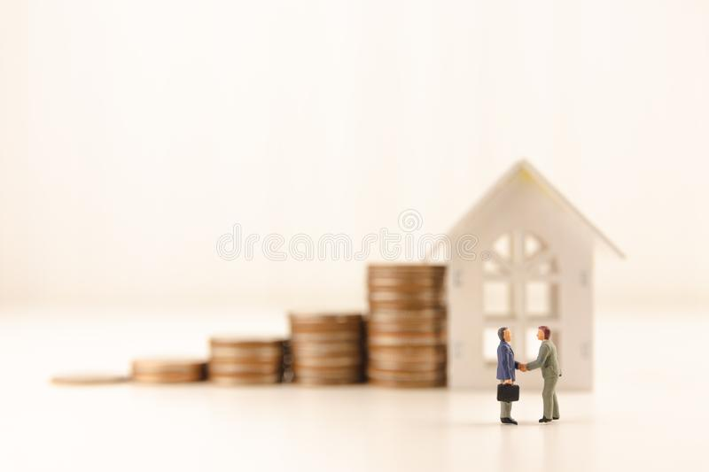 Concept save money financial business investment. Miniature people standing and handshake for successful of investment deal with coin growing growth saving money stock image