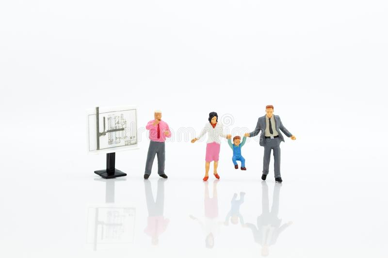 Miniature people: Students find out about special course. Image use for study the fundamentals before class, education concept.  royalty free stock image