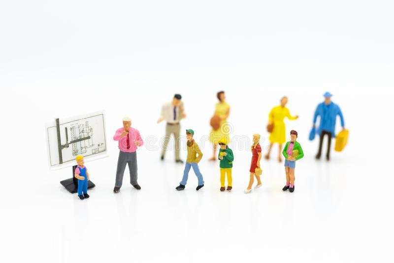 Miniature people: Students find out about special course. Image use for study the fundamentals before class, education concept.  royalty free stock photos