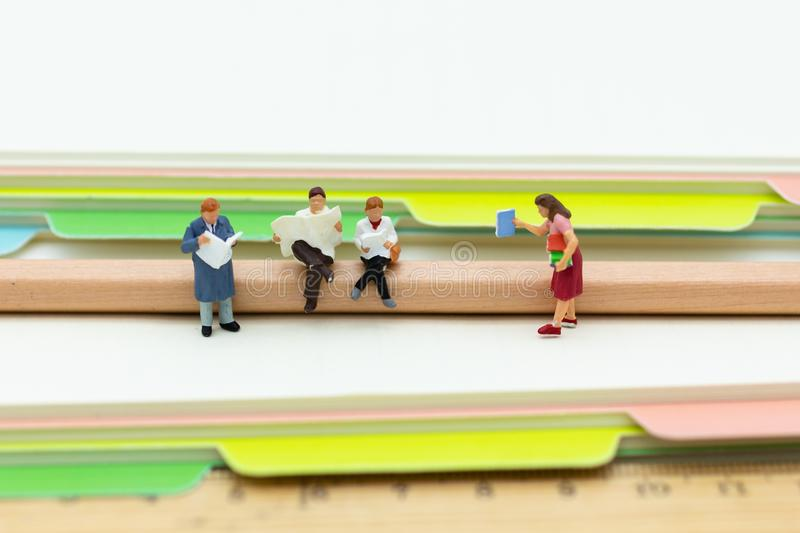 Miniature people: Students read books . Image use for learning, education concept.  stock photos