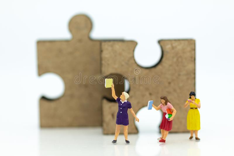 Miniature people: Students read books, keep books on bookshelves . Image use for education concept.  royalty free stock photography