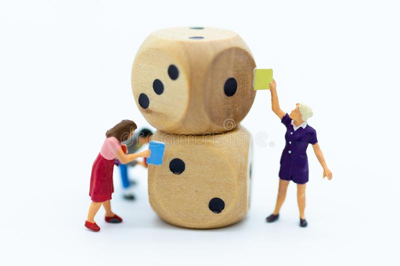 Miniature people: Students read books, keep books on bookshelves made of dice. Image use for education concept.  stock photo