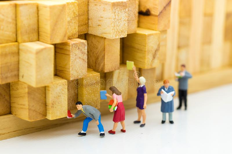 Miniature people: Students read books, keep books on bookshelves. Image use for education concept stock images