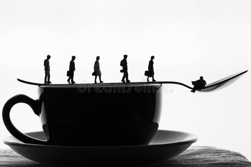 Miniature people taking morning coffee royalty free stock photo