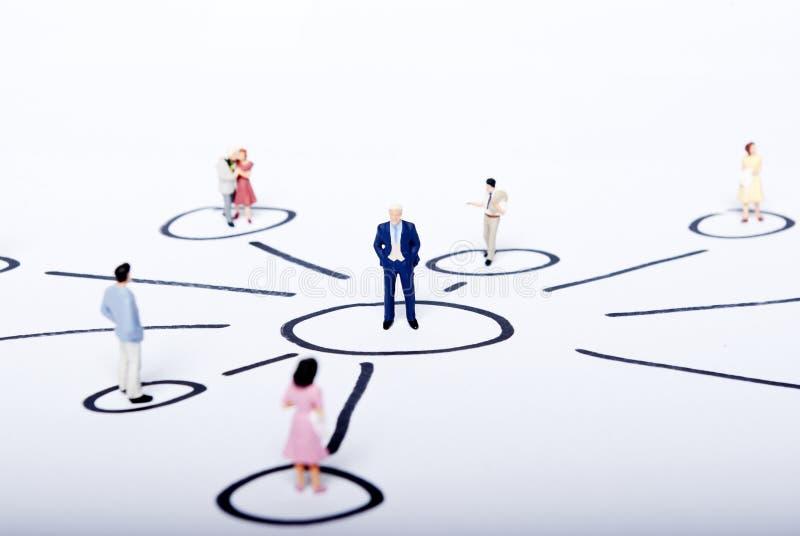 Miniature people on team. Work royalty free stock image