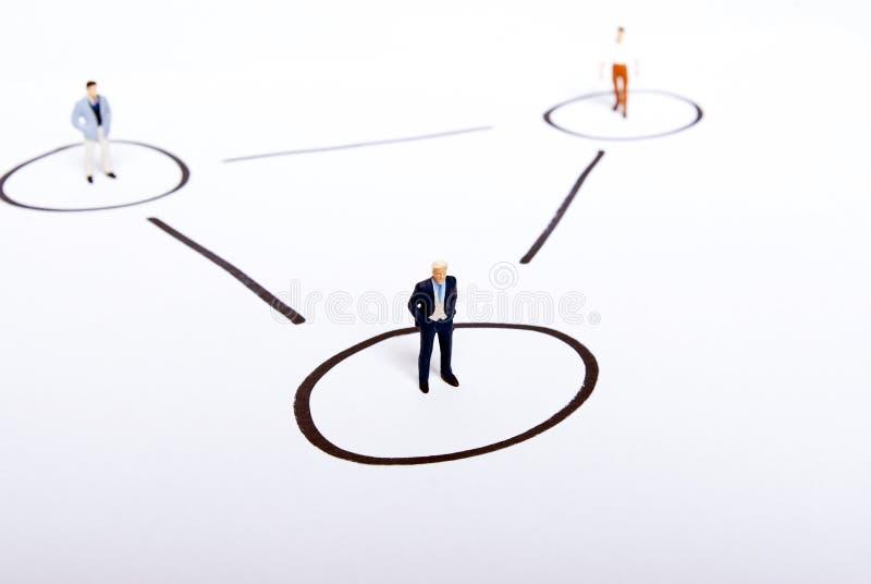 Miniature people on team. Work stock images