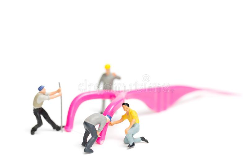 Miniature people : The team work on Dental floss. Isolate on white background , Dental clinic concept royalty free stock image