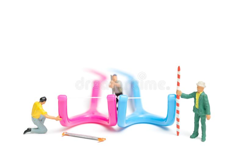 Miniature people : The team work on Dental floss. Isolate on white background , Dental clinic concept stock photos