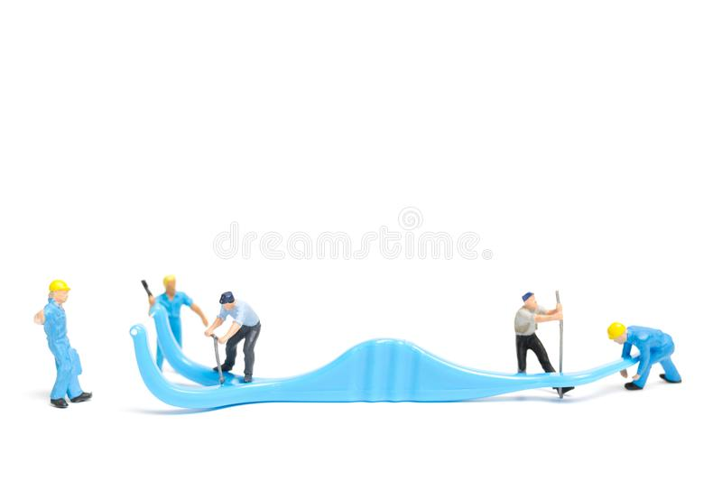 Miniature people : The team work on Dental floss. Isolate on white background , Dental clinic concept stock photography