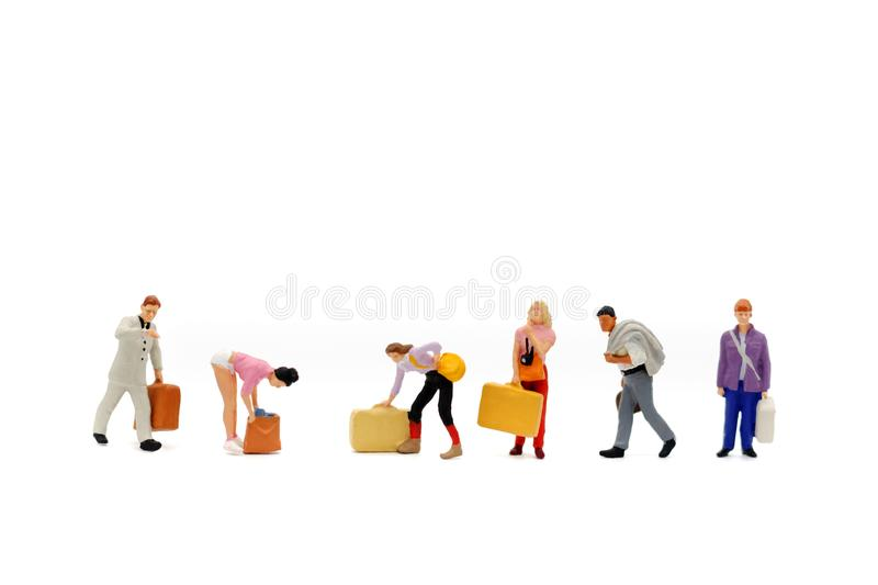 Miniature people: Travel teams with the bag on white background. royalty free stock image
