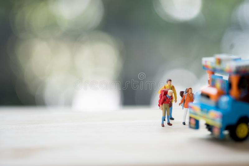Miniature people : Traveler with backpack hitchhiking Thai farming trucks stock photography