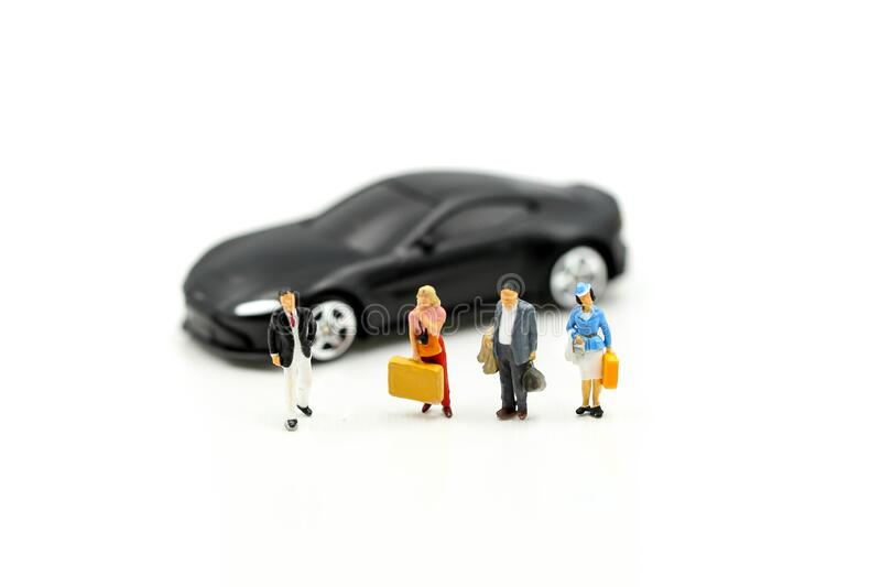 Miniature people : traveler with car,Concept for travel around direction to destination with car dealer, cars exhibition show or. Car insurance for sale royalty free stock photo