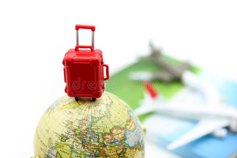 Miniature people : travelers with backpack standing on coins sta stock images