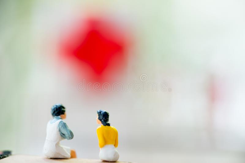 Miniature people : two wife gossip after housework finished. Concept of wife rest after hard work royalty free stock photos
