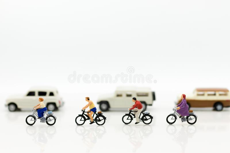 Miniature people: People use bicycles as vehicles to travel. Image use for energy reduction and exercise in everyday stock photo