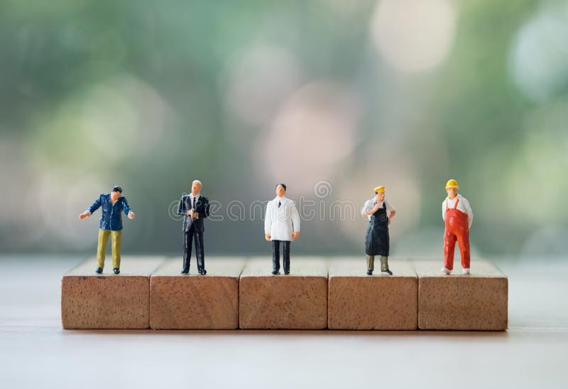 Miniature people of various of career. Recruitment and business concept. Miniature people of various of career. The future of work, competition and business stock images