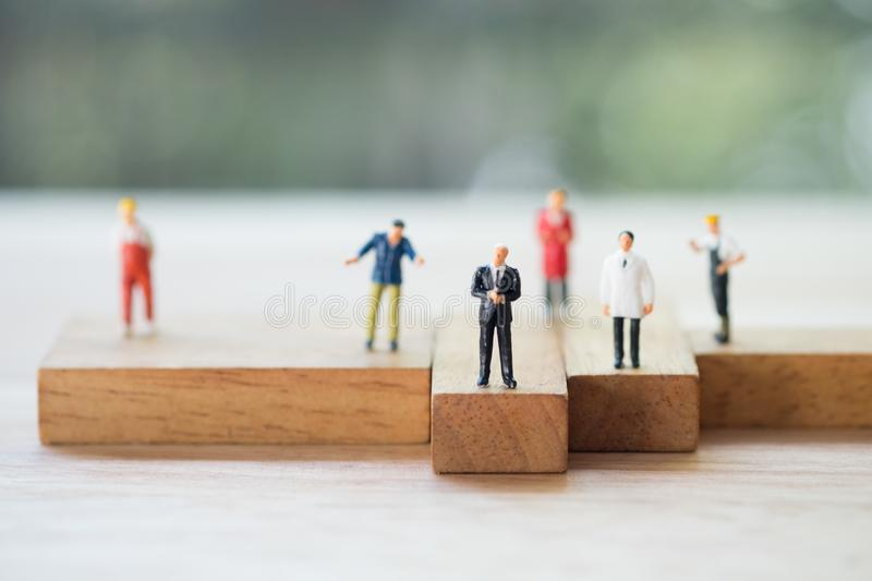 Miniature people of various of career. Recruitment and business concept. Miniature people of various of career. The future of work, competition and business stock image