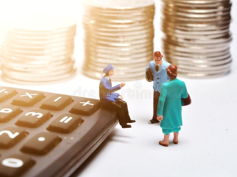 Miniature People walking on ruler with coin stacks. Concept of business people work calculated to success royalty free stock photography