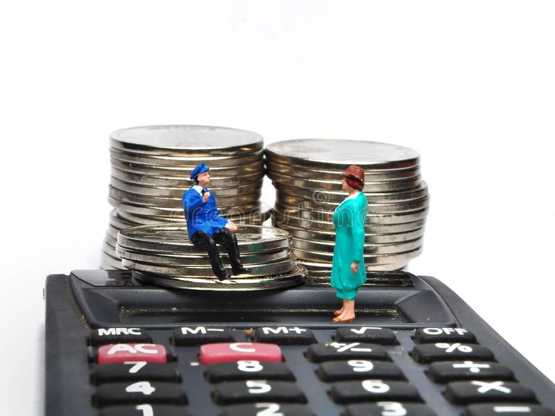 Miniature People walking on ruler with coin stacks. Concept of business people work calculated to success stock images