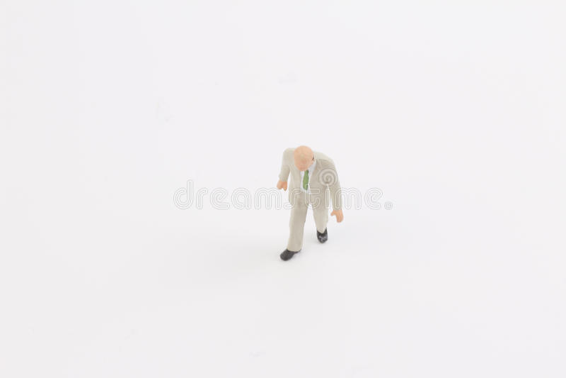 Miniature people on white background. Toys of mini people at the fun mini world stock photos