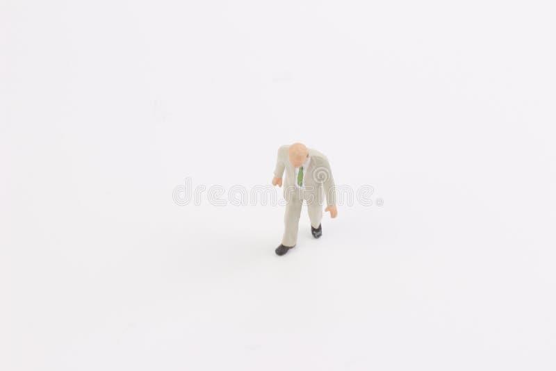 Miniature people on white background. Toys of mini people at the fun mini world stock image