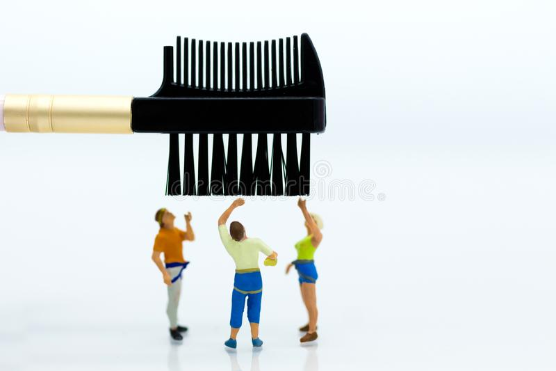 Miniature people: Women and brush. Image use for Women with beauty, beautiful makeup concept.  stock images