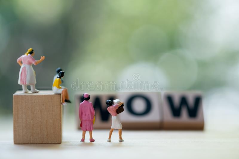 Miniature people : Women looking for buy goods grand sale and discount royalty free stock images