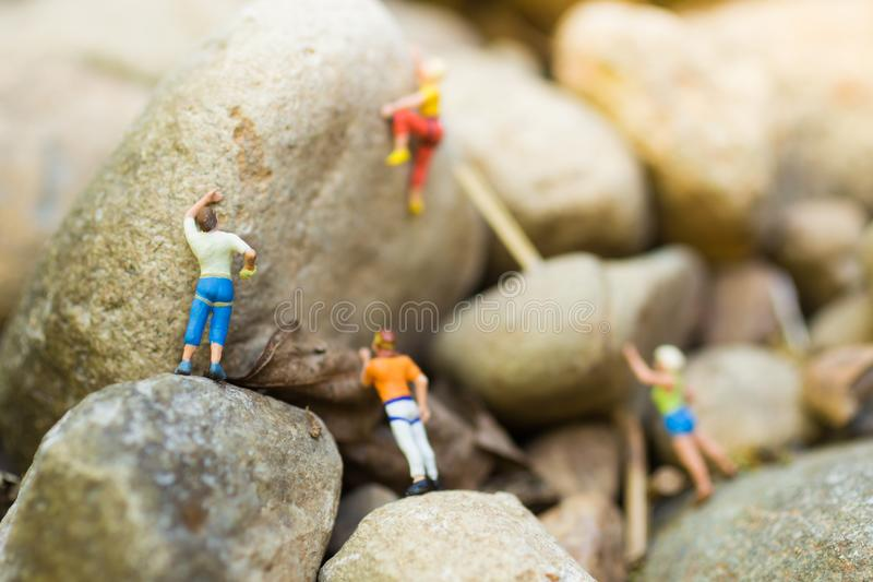 Miniature people : Women are playing high climbing sport. Used as a background for holiday adventure travel business concept.  stock photo