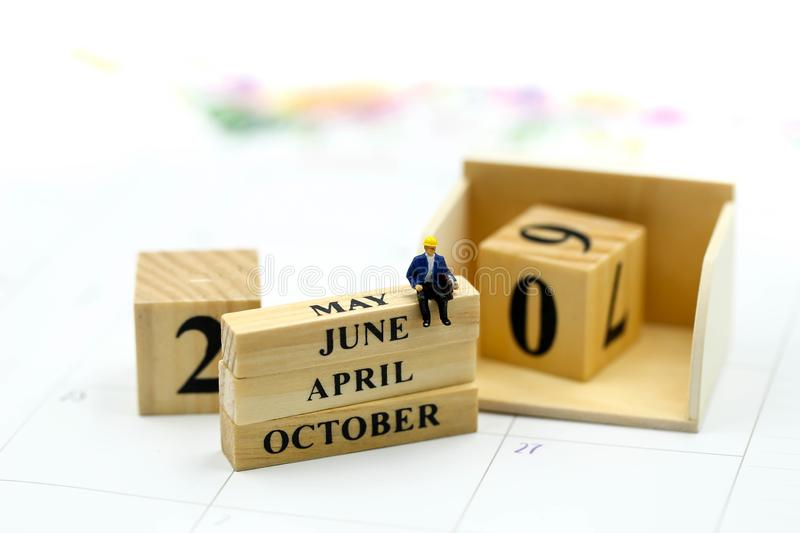 Miniature people : Wooden block calendar date and mounth with miniworld.  stock image