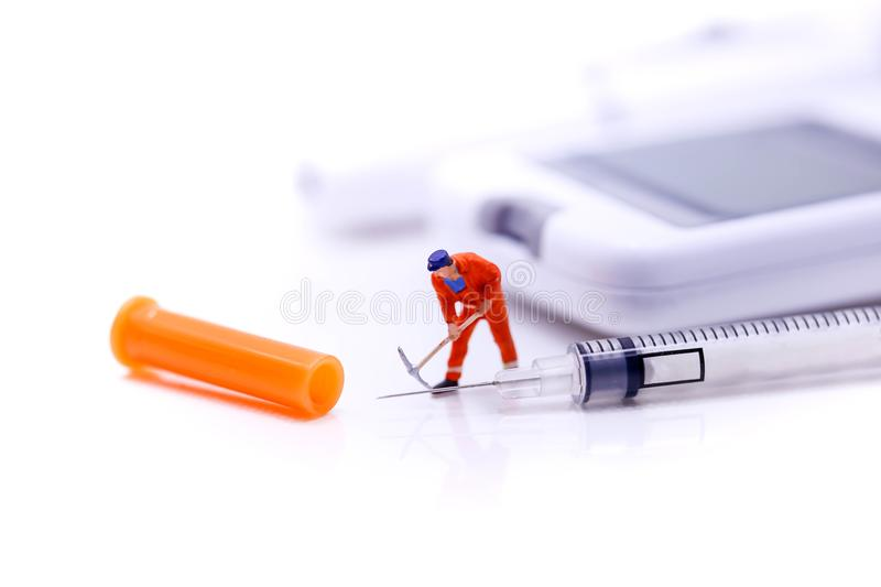 Miniature people : Worker with Diabetes blood glucose test on i stock image