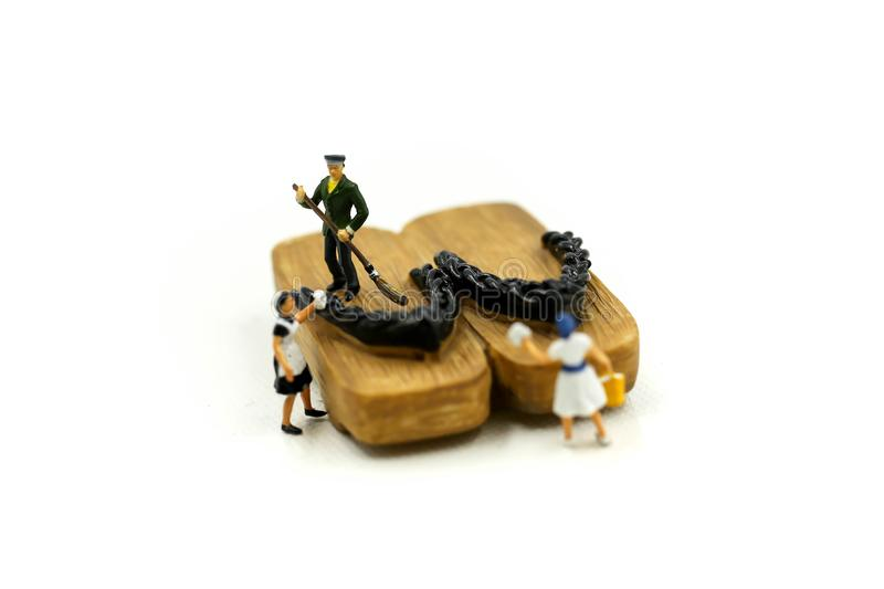 Miniature people : worker,maid cleaning Japanese wooden shoes g. Eta stock images