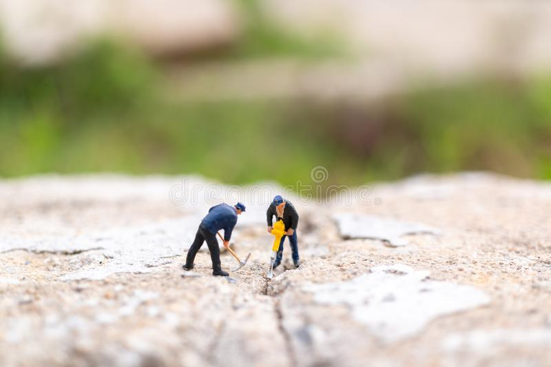 Miniature people : Worker team working on  concrete with cracked. Team work  concept stock photos