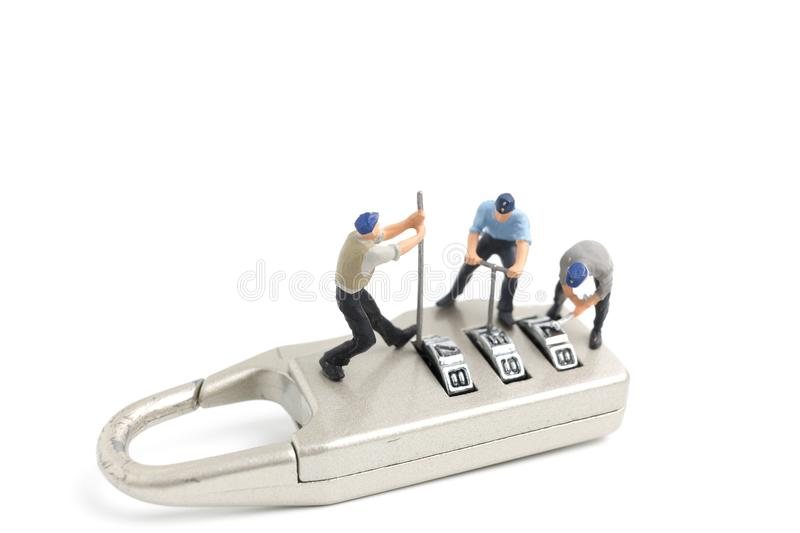 Miniature people worker : Teamwork helps to unlock password on the keys. Team work concept royalty free stock photography