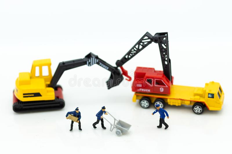 Miniature people: Workers help to moving crates for building home . Image use for construction, business concept.  stock photo