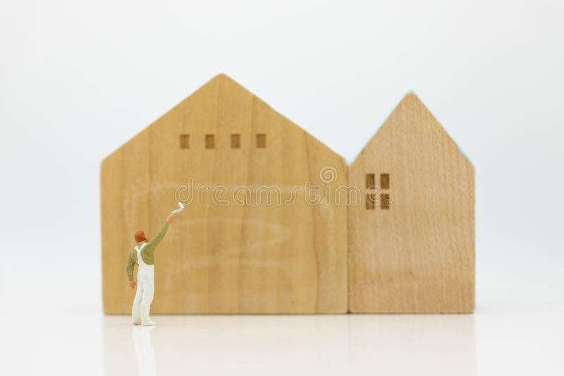 Miniature people: Workers are painting color the home. Image use for Construction business concept.  stock image