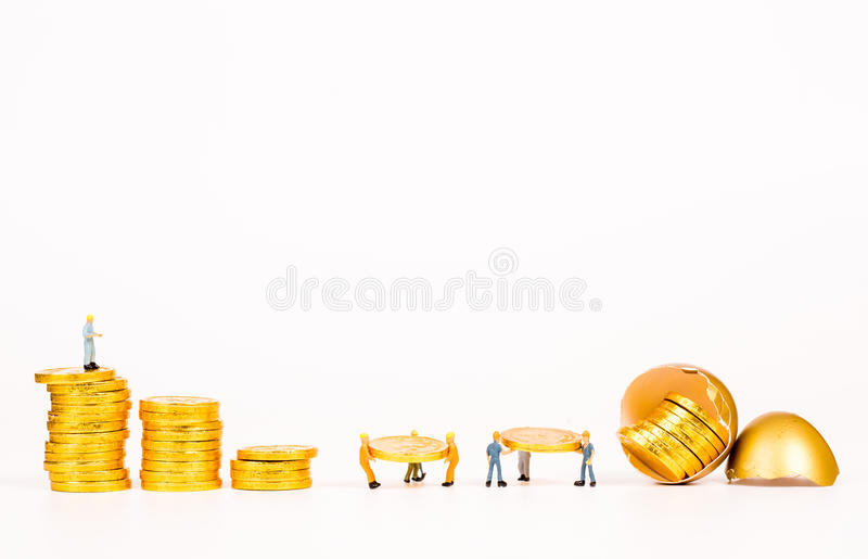 Miniature people working with gold egg. On white background royalty free stock photo