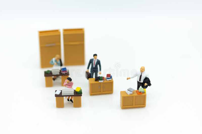 Miniature people : Working in the office, salary man, talent development work. Image use for keeping money for future.  royalty free stock image