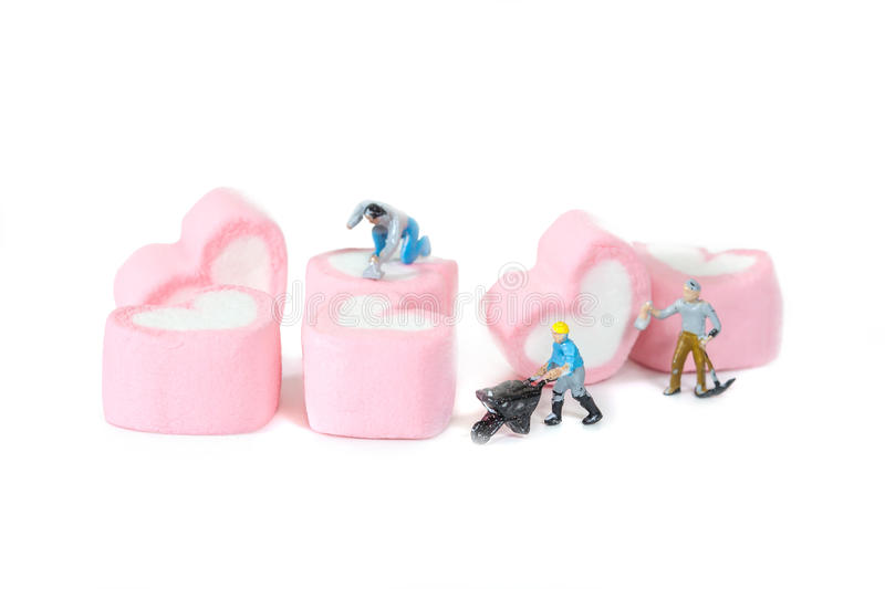 Miniature people working with sweet marshmallow candies ,. Selective focus stock photos