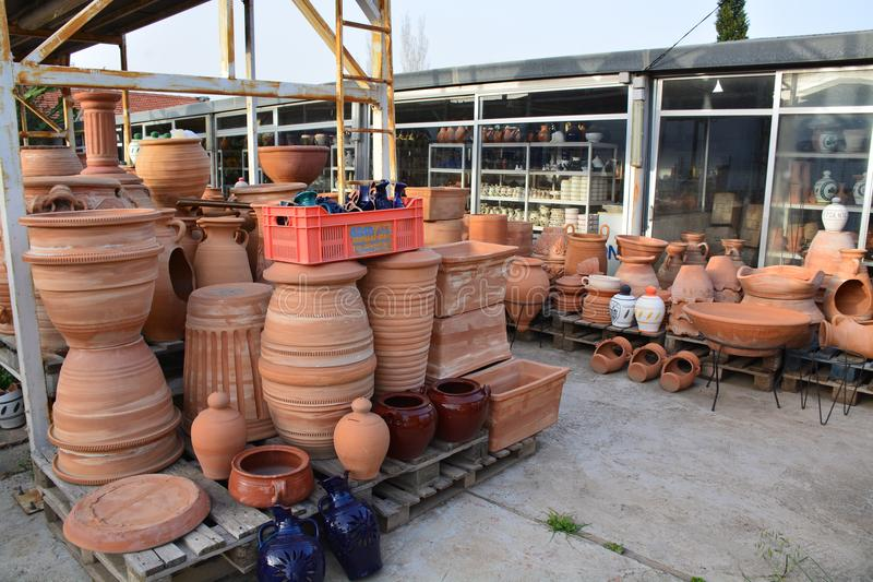 In the workshop of the potter`s master stock photos